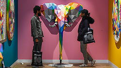 "© Licensed to London News Pictures. 04/10/2019. LONDON, UK. Visitors view ""Elefunk"", 2019, by Okuda San Miguel at Moniker International Art Fair, an urban contemporary art fair taking celebrating its 10 year anniversary in the UK.  The fair is  place at Chelsea's Sorting Office air until 6 October 2019.  Photo credit: Stephen Chung/LNP"