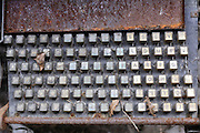 rusted keyboard on a type setting machine