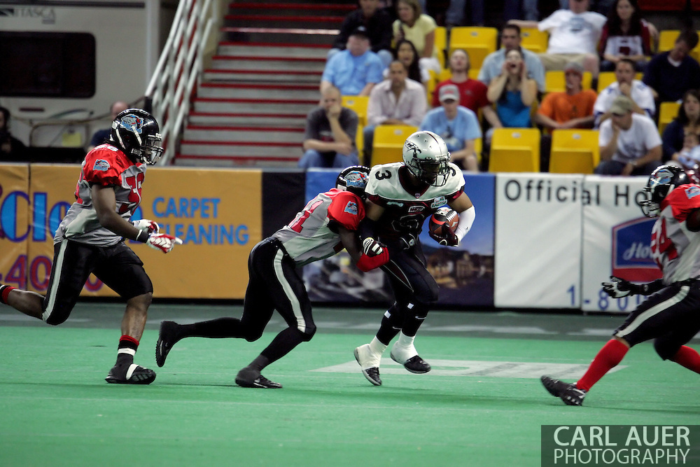 6-28-2007: Anchorage, AK - Alaska Wild's Thomas Ford Jr. (3) tries to get a few yards in the Alaska Wild 47 to 53 loss to the CenTex Barracudas at the Sullivan Arena.