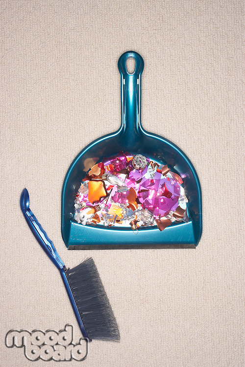 Shattered ornament in dustpan view from above