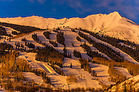 Ski slopes at Aspen/Snowmass ski resort at sunrise, Colorado USA.