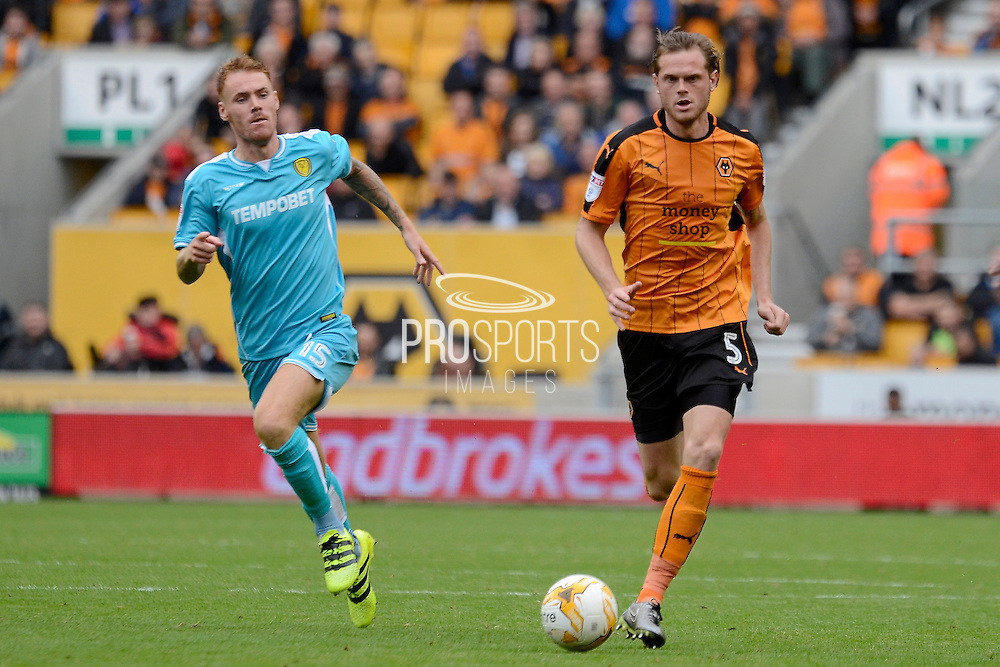 Wolverhampton Wanderers defender Richard Stearman (5) on the attack tracked by Burton Albion defender Tom Naylor (15) 0-0 during the EFL Sky Bet Championship match between Wolverhampton Wanderers and Burton Albion at Molineux, Wolverhampton, England on 10 September 2016. Photo by Alan Franklin.