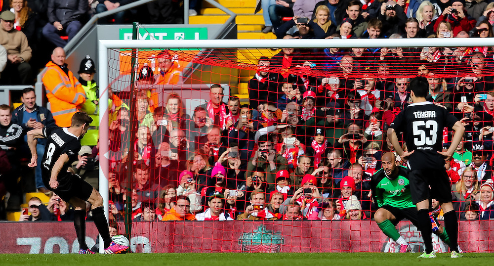 Steven Gerrard scores his first half penalty against Pepe Reina - Photo mandatory by-line: Dougie Allward/JMP - Mobile: 07966 386802 - 29/03/2015 - SPORT - Football - Liverpool - Anfield Stadium - Gerrard's Squad v Carragher's Squad - Liverpool FC All stars Game