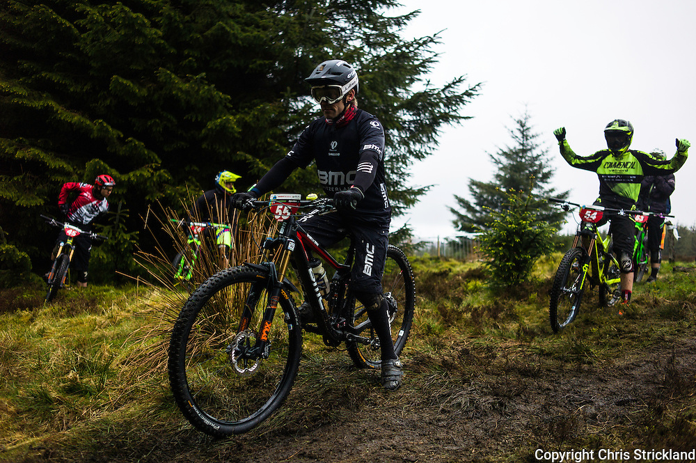 Glentress, Peebles, Scotland, UK. 31st May 2015. Florian Golay (55) and Cedric Ravenel stretching his arms at the start of Stage 5 at The Enduro World Series Round 3 taking place on the iconic 7Stanes trails during Tweedlove Festival.