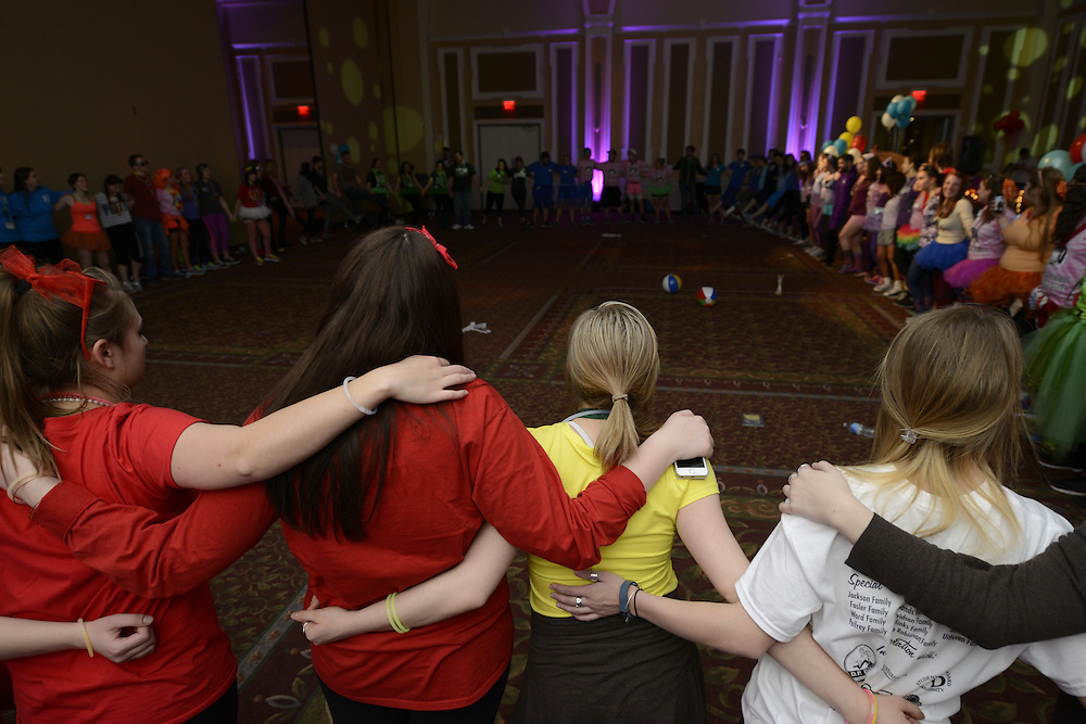 Participants join in a circle to send their love to the families and children benefitted by the BobcaThon and Ronald McDonald's House of Central Ohio. Photo by Olivia Wallace