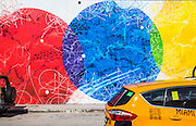 Mural on a Wynwood Wall, plus a yellow Miami taxi in foreground