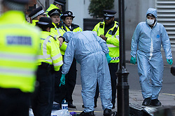 © Licensed to London News Pictures. 09/03/2020. London, UK. Forensics officers work on Great Scotland Yard after a man was shot by armed police late last night. Police say this incident is not being treated as terror related. Photo credit: George Cracknell Wright/LNP