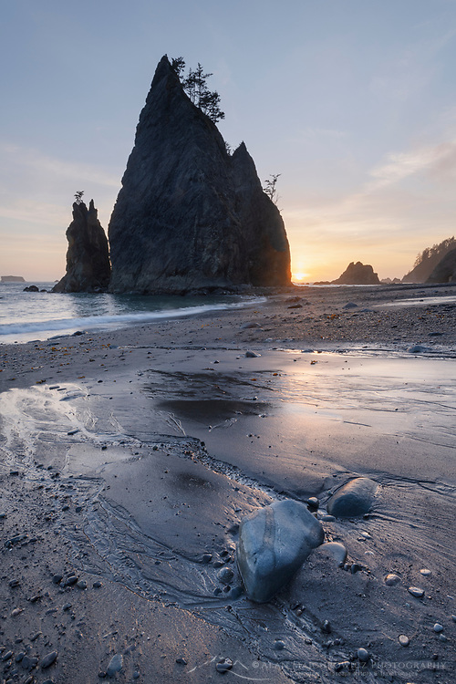 Setting sun behind Split Rock  on Rialto Beach, Olympic National Park