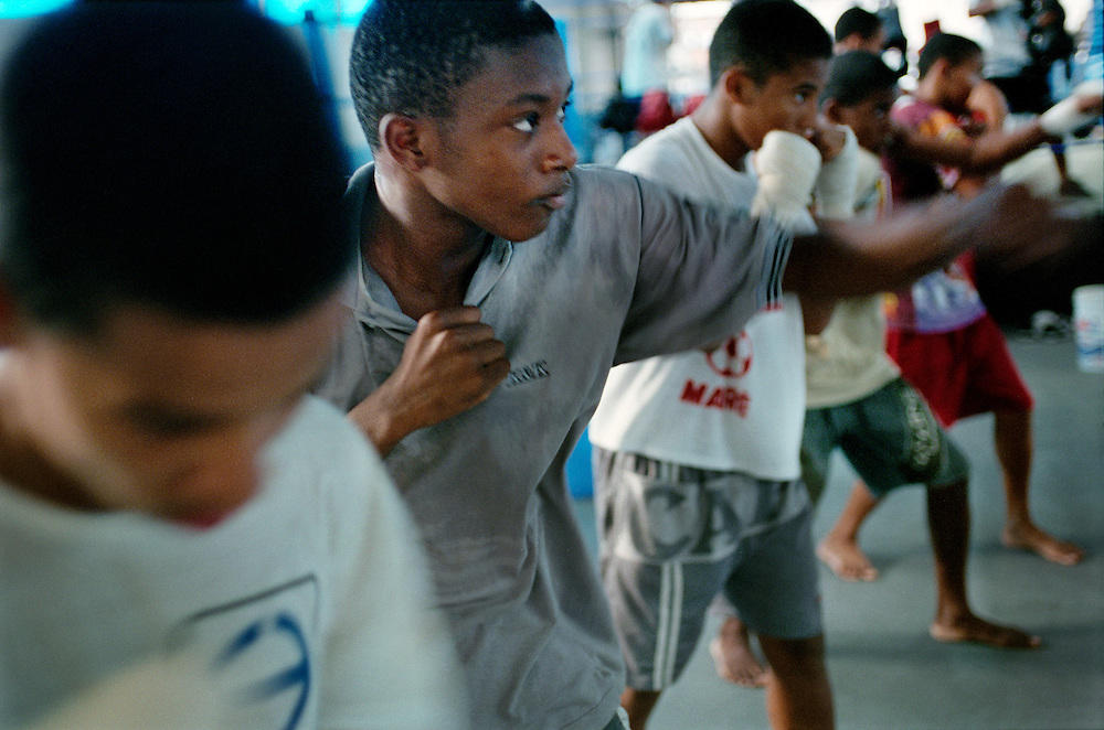 Boxing club set up inside Complexo do Mare, one of the most dangerous favelas to help keep children off the streets. In Rio, 3,500 teenagers aged between fourteen to nineteen die every year. In the city's three most dangerous favelas, the number of youngsters killed every year is higher than that of the whole state of Rio. Rio de Janerio, Brazil. 2001