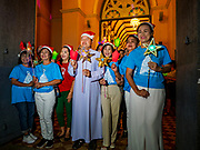 "23 DECEMBER 2018 - CHANTABURI, THAILAND: The Christmas procession leaves the church at the Cathedral of the Immaculate Conception's Christmas Fair in Chantaburi. Cathedral of the Immaculate Conception is holding its annual Christmas festival, this year called ""Sweet Christmas @ Chantaburi 2018"". The Cathedral is the largest Catholic church in Thailand and was founded more than 300 years ago by Vietnamese Catholics who settled in Thailand, then Siam.   PHOTO BY JACK KURTZ"