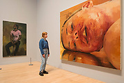 UNITED KINGDOM, London: 26 February 2018 <br /> A visitor takes a closer look at Jenny Saville's 'Reverse' 2002-2003 at The Tate Britain this morning. The painting forms part of Tate Britain's landmark exhibition entitled 'All Too Human: Bacon, Freud and a Century of Painting Life' which celebrates the intense experience of life captured with paint. <br /> The exhibition runs from 28 February - 27 August 2018.<br /> Photograph: Rick Findler