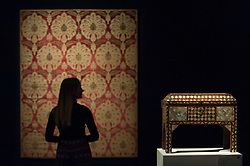 © Licensed to London News Pictures. 20/10/2017. London, UK. A staff member views a large Ottoman voided silk velvet and metal threaded panel (catma) with carnations, late 16th century, (Est. GBP80-120k), next to an Ottoman tortoiseshell and mother-of-pearl casket, 18-19th century, (Est. GBP5-7k), at a preview of Islamic, Middle Eastern and other artworks which be auctioned at Sotheby's New Bond Street on 24 and 25 October. Photo credit : Stephen Chung/LNP