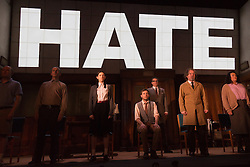 "© Licensed to London News Pictures. 08/05/2014. London, England. Pictured: Cast with Sam Crane as Winston (grey waistcoat) and Tim Dutton as O'Brien (centre right) during the Two Minutes Hate. The Play ""1984"" by George Orwell transfers to the Playhouse Theatre until 19 July 2014. A new adaptation for the stage by Robert Icke and Duncan MacMillan. With Sam Crane as Winston Smith. Photo credit: Bettina Strenske/LNP"
