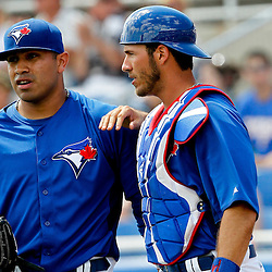 March 16, 2012; Dunedin, FL, USA; Toronto Blue Jays starting pitcher Ricky Romero (24) and catcher J.P. Arencibia (9) talk during the top of the fourth inning during a spring training game against the Tampa Bay Rays at Florida Auto Exchange Stadium. Mandatory Credit: Derick E. Hingle-US PRESSWIRE
