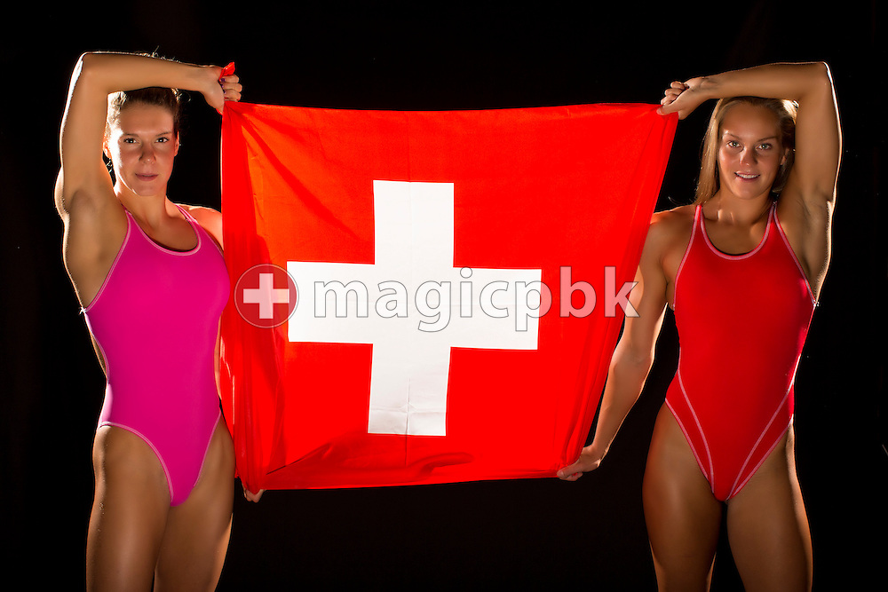 Swimmers Svenja STOFFEL (L) and Sasha TOURETSKI of Switzerland are pictured while holding a Swiss flag during a portrait photo session in a mobile studio at the Centro sportivo nazionale della gioventu in Tenero, Switzerland, Sunday, Aug. 10, 2014. (Photo by Patrick B. Kraemer / MAGICPBK)