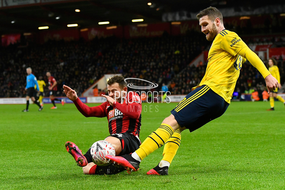 Ryan Fraser (24) of AFC Bournemouth challenges Shkodran Mustafi (20) of Arsenal during the The FA Cup match between Bournemouth and Arsenal at the Vitality Stadium, Bournemouth, England on 27 January 2020.
