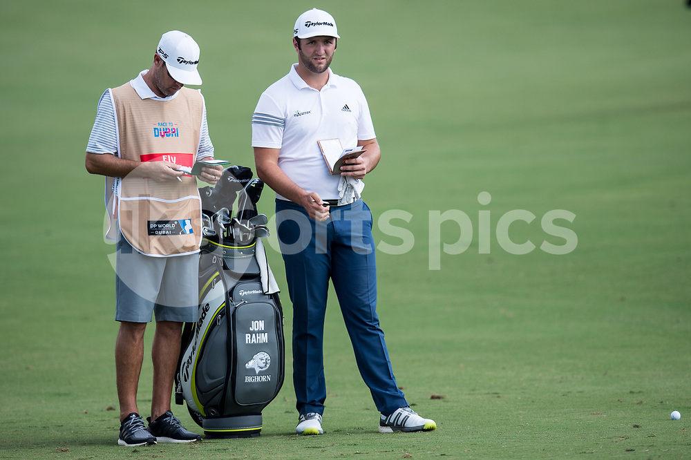 Jon Rahm of Spain consults with his caddy during the European Tour DP World Championship at Jumeirah Golf Estates, Dubai, UAE on 16 November 2017. Photo by Grant Winter.