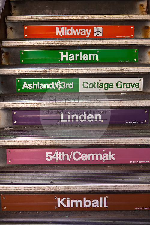 "Station signs marking the transit lines on the stairs of the ""L"", the elevated rapid transit system in Chicago, IL, USA."