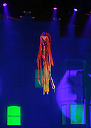 An acrobat performs during the 2009 Victoria's Secret Fashion show at the 26th St Armory in New York City on November 19, 2009.