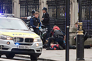 UNITED KINGDOM, London: 22 March 2017 A victim lies bleeding on the floor after a suspected terror attack outside the Houses of Parliament in Westminster, London. Rick Findler / Story Picture Agency