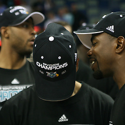 15 April 2008: Mike James (right) talks to Jannero Pargo who nods his head showing off the Hornets Division Champions hat as Hornets players celebrate after the Hornets 114-92 Southwestern Division clinching victory over the Clippers at the New Orleans Arena in New Orleans, Louisiana.
