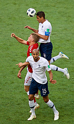MOSCOW, RUSSIA - Tuesday, June 26, 2018: Denmark's Andreas Cornelius challenges for a header with France's Raphael Varane during the FIFA World Cup Russia 2018 Group C match between Denmark and France at the Luzhniki Stadium. (Pic by David Rawcliffe/Propaganda)