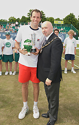 NOTTINGHAM, ENGLAND - Sunday, June 14, 2009: Sheriff of Nottingham Councillor Leon Unczur presents Greg Rusedski (GBR) with the runners-up Legends' Trophy on finals day of the Tradition Nottingham Masters tennis event at the Nottingham Tennis Centre. (Pic by David Rawcliffe/Propaganda)