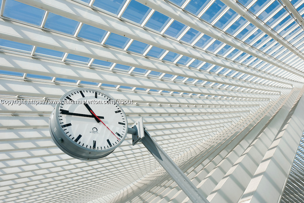 Clock detail inside Liège-Guillemins modern railway station designed by architect Santiago Calatrava  in Liege Belgium