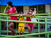 """22 JANUARY 2018 - CAMALIG, ALBAY, PHILIPPINES: Evacuees from the eruption of the Mayon volcano at Bariw National High School, the evacuation center they've been assigned to. There were a series of eruptions on the Mayon volcano near Legazpi Monday. The eruptions started Sunday night and continued through the day. At about midday the volcano sent a plume of ash and smoke towering over Camalig, the largest municipality near the volcano. The Philippine Institute of Volcanology and Seismology (PHIVOLCS) extended the six kilometer danger zone to eight kilometers and raised the alert level from three to four. This is the first time the alert level has been at four since 2009. A level four alert means a """"Hazardous Eruption is Imminent"""" and there is """"intense unrest"""" in the volcano. The Mayon volcano is the most active volcano in the Philippines. Sunday and Monday's eruptions caused ash falls in several communities but there were no known injuries.    PHOTO BY JACK KURTZ"""