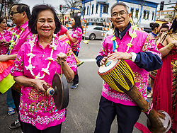 April 29, 2017 - Minneapolis, Minnesota, U.S - Thai-Americans wearing traditional Thai holiday shirts perform Thai music during the parade at Songkran Uptown. Several thousand people attended Songkran Uptown on Hennepin Ave in Minneapolis for the city's first celebration of Songkran, the traditional Thai New Year. Events included a Thai parade, a performance of the Ramakien (the Thai version of the Indian Ramayana), a ''Ladyboy'' (drag queen) show, and Thai street food. (Credit Image: © Jack Kurtz via ZUMA Wire)