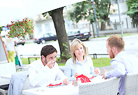 Businesspeople having food at outdoor restaurant