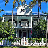 Home in Truman Annex Neighborhood in Key West, Florida<br /> While flocking to see the Little White House, most visitors to Key West fail to appreciate the beauty of the nearby homes like this one on Front Street.  This gated island community is called the Truman Annex. They were previously residences of officers who served at the 100 acre Naval Station Key West.  During the 1990s, they were restored into mansions complete with white picket fences.