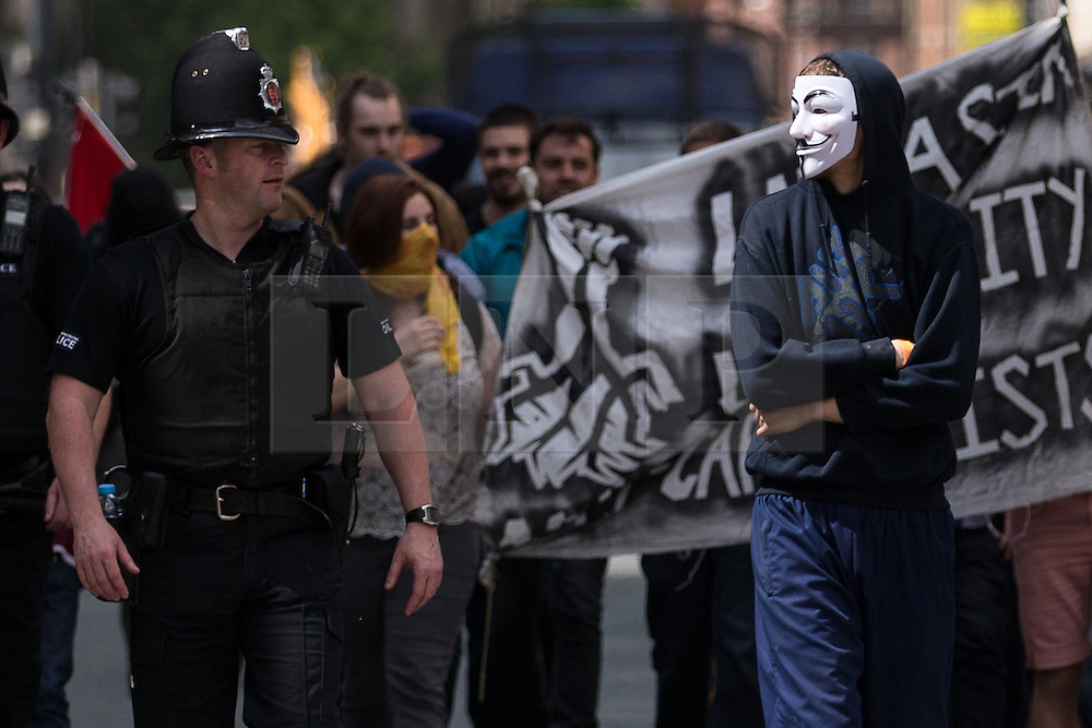"© Licensed to London News Pictures . 23/05/2015 . Manchester , UK . A group of protesters peel away from the Piccadilly Gardens and march impromptu along Princess Street . A demonstration , organised by "" The People's Assembly "" , against austerity in Piccadilly Gardens in Central Manchester , attended by approximately 2000 people . Photo credit : Joel Goodman/LNP"