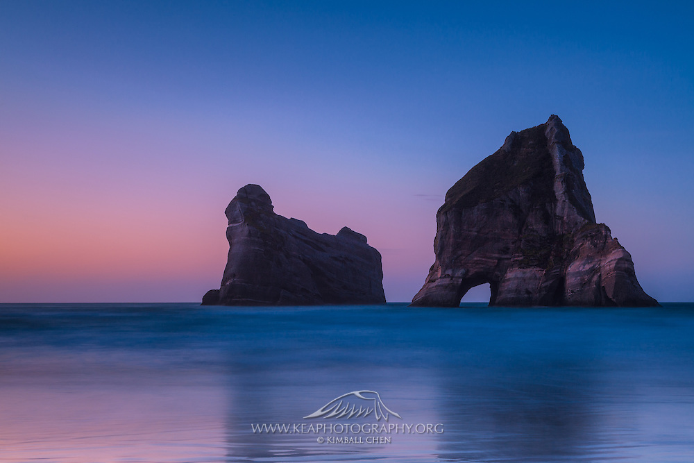 Sunset over Archway Islands at Wharariki Beach, New Zealand