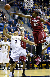 February 13, 2010; Berkeley, CA, USA;  Washington State Cougars forward DeAngelo Casto (23) blocks a shot from California Golden Bears guard Jerome Randle (3) during the first half at the Haas Pavilion.  California defeated Washington State 86-70.