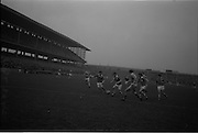 21/02/1965.02/21/1965.21 February 1965.Munster v Ulster Railway Cup semi-final at Croke Park. The final score was Ulster 0-14 Munster 0-9..Griffin of Munster kicking the ball at his feet towards the Ulster goalmouth..