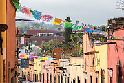 Papel picado banners decorate a street in the historic center of San Miguel de Allende, Mexico.