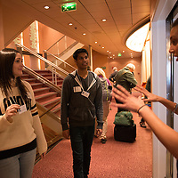 Students Chloe Lloyd from Chapman University and Neeraj Maheshwari from the Univeristy of Cincinnati receive instructions for their work study positions during Embarkation day for the Semester at Sea Spring 2014 Voyage, January 10th 2014, in Ensenada, Mexico.