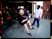 Seretha Woods-Bradford (right) and her husband Woodrow Bradford, 58, along with her grandson Eric Lowe, 8 spend time in the driveway before going to a birthday party. Bradford, 58, is a retired Navy Seal who works at BP Amoco Oil company in Whiting, Ind., and has been married to Seretha for 18 years.