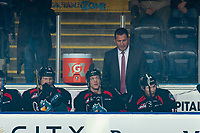 KELOWNA, CANADA - OCTOBER 23: Former NHL player, Adam Foote stands on the bench for his first game as at the head coach of the Kelowna Rockets against the Swift Current Broncos on October 23, 2018 at Prospera Place in Kelowna, British Columbia, Canada.  (Photo by Marissa Baecker/Shoot the Breeze)
