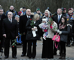 © Licensed to London News Pictures. 17 Jan 2013. Brize Norton, Oxfordshire. His baby Lilly Faith Walker (20mths) and his girlfriend Abbie Revill (23yrs) with the other family members. Repatriation of Sapper Richard Reginald Walker from 28 Engineer Regiment who was shot in an apparent 'insider attack' by a member of the Afghan National Army (ANA) at Patrol Base Hazrat in the Nahr-e Saraj district of Helmand province on Monday 7 January 2013 . Photo credit : MarkHemsworth/LNP