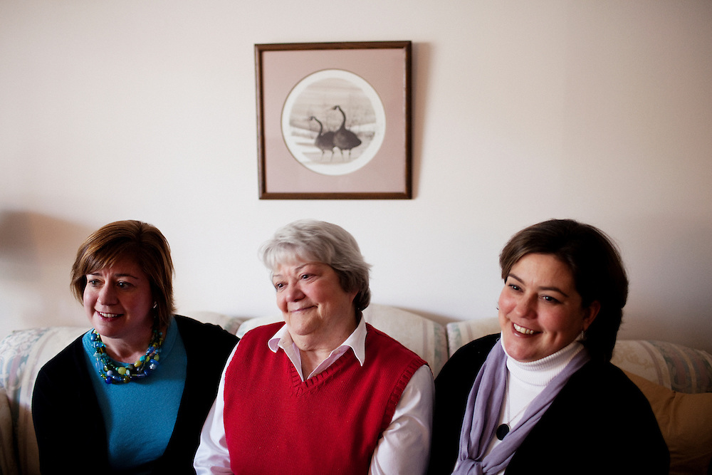 Linda Groeber, 67 (center), and her daughters Tracey Brown (R) and Annie Groeber (L), pose for a portrait during a family visit in Lutherville-Timonium, Maryland on Wednesday, January 13, 2010. As she ages Linda has relied more on her daughters Tracey Brown and Annie Groeber to help with day-to-day tasks, which can cause tension between the siblings.