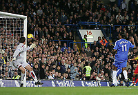 Photo: Lee Earle.<br /> Chelsea v Watford. The Barclays Premiership. 11/11/2006. Chelsea's Didier Drogba (R) puts the ball past Watford keeper Ben Foster for his hat-trick.