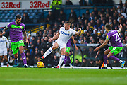 Kalvin Phillips of Leeds United (23) shields the ball from Marlon Pack of Bristol City (21) and Jamie Paterson of Bristol City (20) during the EFL Sky Bet Championship match between Leeds United and Bristol City at Elland Road, Leeds, England on 24 November 2018.