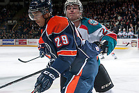 KELOWNA, CANADA -FEBRUARY 1:Tyson Baillie #24 of the Kelowna Rockets skates in to check Edson Harlacher D #29 of the Kamloops Blazers into the boards on February 1, 2014 at Prospera Place in Kelowna, British Columbia, Canada.   (Photo by Marissa Baecker/Getty Images)  *** Local Caption *** Tyson Baillie; Edson Harlacher;