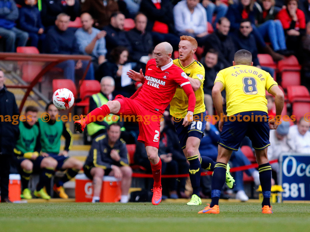 Sean Clohessy of Leyton Orient under pressure from Ryan Taylor or Oxford United during the Sky Bet League 2 match between Leyton Orient and Oxford United at the Matchroom Stadium in London. October 17, 2015.<br /> Carlton Myrie / Telephoto Images<br /> +44 7967 642437