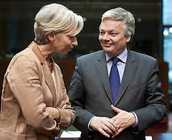 Christine Lagarde, France's finance minister, left, speaks with  Didier Reynders, Belgium's finance minister, right, during the emergency meeting of European Union finance ministers in Brussels, Belgium, on Sunday, May 9, 2010.  European Union finance ministers meet today to hammer out the details of an emergency fund to prevent a sovereign debt crisis from shattering confidence in the 11-year-old euro. (Photo © Jock Fistick)