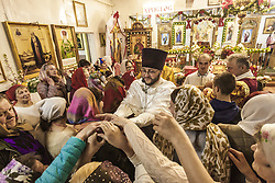 April 28, 2019 - Naroulia, Gomel, Belarus - Priest gives blessed eggs after the holy mass  during the celebrations of the Easter in Naroulia, Belarus, on April 27, 2019. (Credit Image: © Celestino Arce/NurPhoto via ZUMA Press)