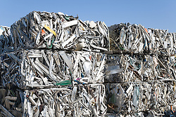 Baled Aluminium after being through the baler at a metal recycling centre waiting to be sold on to be reused,
