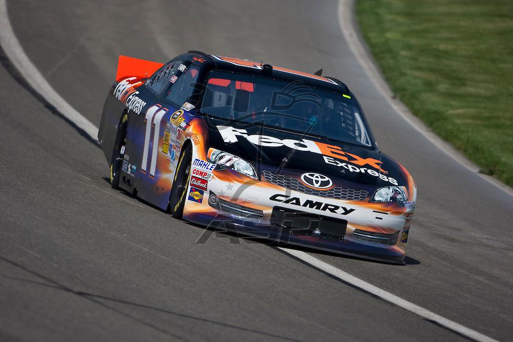 FONTANA, CA - MAR 23, 2012:  Denny Hamlin (11) takes the pole for Sunday's Auto Club 500 NASCAR Sprint Cup race at the Auto Club Speedway in Fontana, CA.